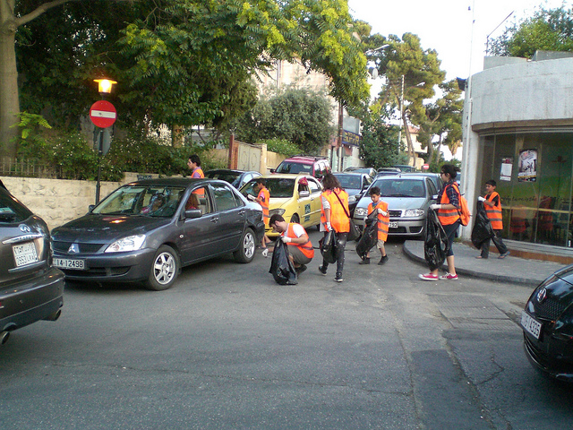 Volunteers picking up trash along Rainbow Street
