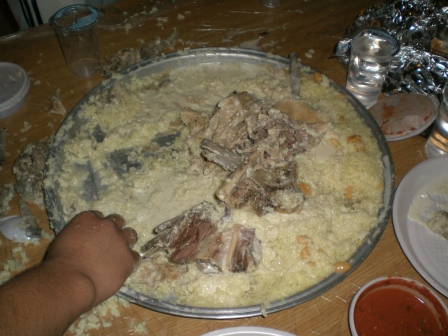Mansaf: a traditional Jordanian dish of rice, lamb and tangy yogurt sauce eaten with the hands