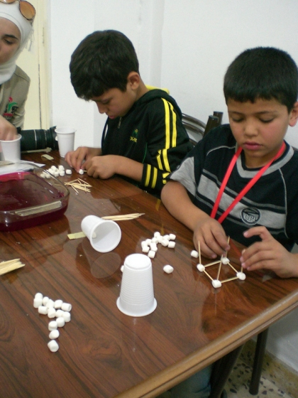 "Kids are challenged to build ""earthquake""-proof marshmallow towers."